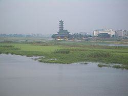 "Daye Lake on the southern edge of Daye's urban core. The Qing Long Ta (""Purple Dragon Pagoda"") is in the middle."