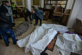 Dead bodies in a makeshift hospital and morgue in the hotel Ukraine lobby. Clashes in Kyiv, Ukraine. Events of February 20, 2014.jpg