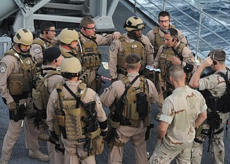 Law Enforcement Detachments - U.S. Navy sailors assigned to a visit board search and seizure team and Coast Guardsmen assigned to the Coast Guard Law Enforcement Detachment