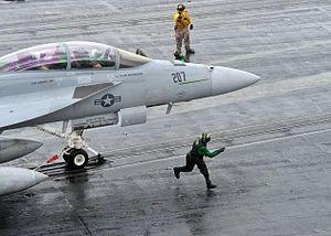 Defense.gov News Photo 110307-N-0569K-093 - An F A-18F Super Hornet aircraft assigned to Strike Fighter Squadron 211 prepares to launch from catapult three during cyclic flight operations.jpg