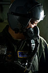 Defense.gov News Photo 120223-F-RH756-270 - U.S. Air Force Master Sgt. Malcolm Mercado a 40th Airlift Squadron loadmaster is hooked up to the oxygen system prior to opening the ramp door on.jpg
