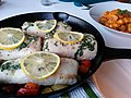 Delicious fish in a cast iron pan with slices of lemon and herbs (13660264495).jpg