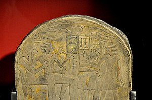 Atenism - Detail of funerary stela of Amenemhat. The name of God Amun was erased by Akhenaten's agents. Limestone, painted. From Egypt, early 18thh Dynasty. The Burrell Collection, Glasgow