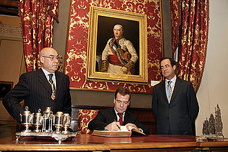 Russian President Dmitry Medvedev signs the Book of Distinguished Guests at the Cortes Generales in Madrid on 3 March 2009 Dmitry Medvedev in Spain 3 March 2009-2.jpg