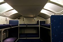 Picture of a crew rest compartment showing bunks and seats