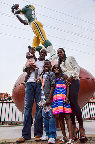 Receiver (statue) - Driver and family pose in front of the statue dedicated in his honor.
