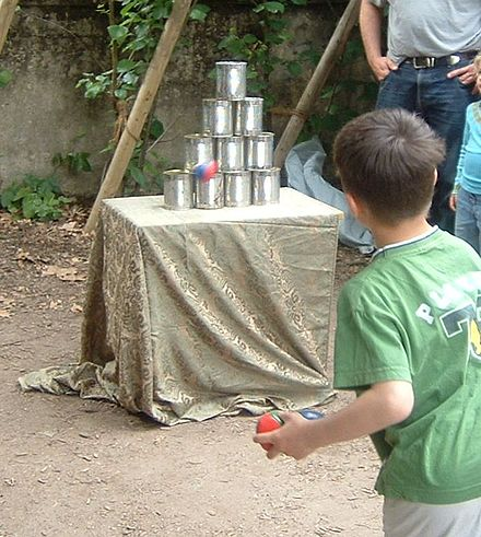 A child playing a can throwing game Dosenwerfen 2008 035.jpg