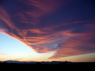 Cloud - Windy evening twilight enhanced by the Sun's angle, can visually mimic a tornado resulting from orographic lift