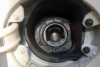 Common ethanol fuel mixtures - Typical warning placed in the fuel filler of U.S. vehicles regarding the capability of using up to E10 and warning against the use of blends between E20 and E85.