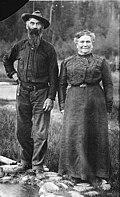 Elcaine Longmire and his wife, Martha Ann standing near creek, Mount Rainier National Park, Washington, ca 1907 (BAR 199).jpeg