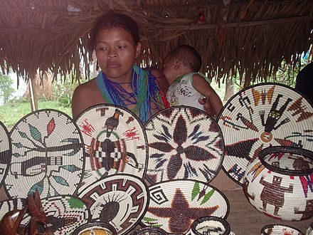 Embera woman selling coiled baskets, Panama Emberabasket.jpg