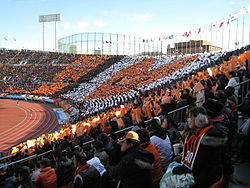 An orange heart is made out of a choreographic performance by fans at the stand.