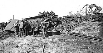 Esmond Train Wreck - Makeshift coffins laid out near one of two wrecked steam engines. Burned Pullman cars are to the right.