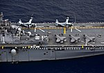 F-35B Lightning II and and MV-22 Osprey aircraft are secured to the flight deck of USS Wasp (LHD 1). (33609534378).jpg