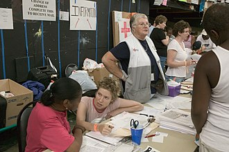Volunteers assist survivors at the Houston Astrodome following Hurricane Katrina in September 2005. FEMA - 15322 - Photograph by Andrea Booher taken on 09-05-2005 in Texas.jpg