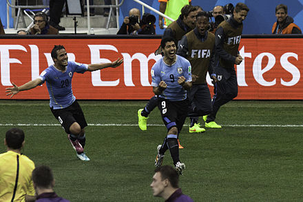 Suarez (middle) celebrating one of his two goals against England at the 2014 World Cup FIFA World Cup 2014 - Uruguay 2 - England 1 - 140619-6454-jikatu (14282608880).jpg