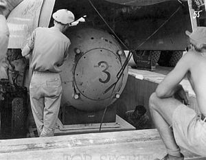 Silverplate - Fat Man test unit being raised from the pit into the bomb bay of a B-29 for bombing practice during the weeks before the attack on Nagasaki