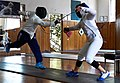 Fencing flèche performed by Ilias Konstantinidis against Eleanna Gousi.jpg