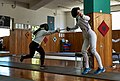 Final stage of the fleche executed by the fencer Anna Panagiotakopoulou having as a target the torso of her opponent.jpg