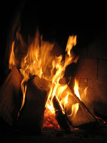 English: A fire burning in a fireplace.