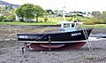 Fishing boat laid up on the shore at Portree, Skye - geograph.org.uk - 1910907.jpg