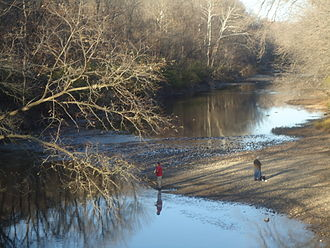 Kickapoo State Recreation Area - Two fishermen on the Vermilion River near the entrance to the Kickapoo State Park.