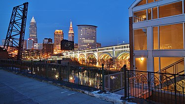 Downtown Cleveland from the Superior Viaduct at night. Flats - 1 (13966708395).jpg