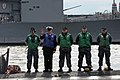 Flickr - Official U.S. Navy Imagery - A Chief from USS Norfolk waves as the boat comes home..jpg