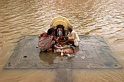 A puja as performed in Ujjain during the Monsoon on the banks of the overflowing river Shipra.
