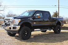 Ford F 250 With Aftermarket Suspension Modifications To Increase Ride Height Ground Clearance