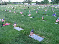 Courtesy of Wikipedia Flags flying at Fort Logan National Cemetery during Memorial Day 2006 licensed under the Creative Commons Attribution ShareAlike 2.5