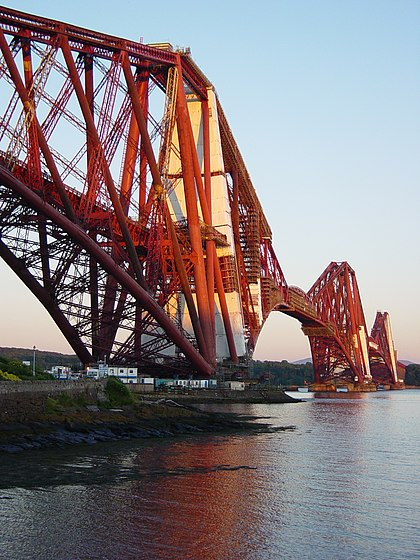 The Forth Bridge, designed by Sir Benjamin Baker and Sir John Fowler, which opened in 1890, and is now owned by Network Rail, is designated as a Category A listed building by Historic Environment Scotland. ForthRailwayBridge 27-06-2005 2150 TakenByEuchiasmus.JPG