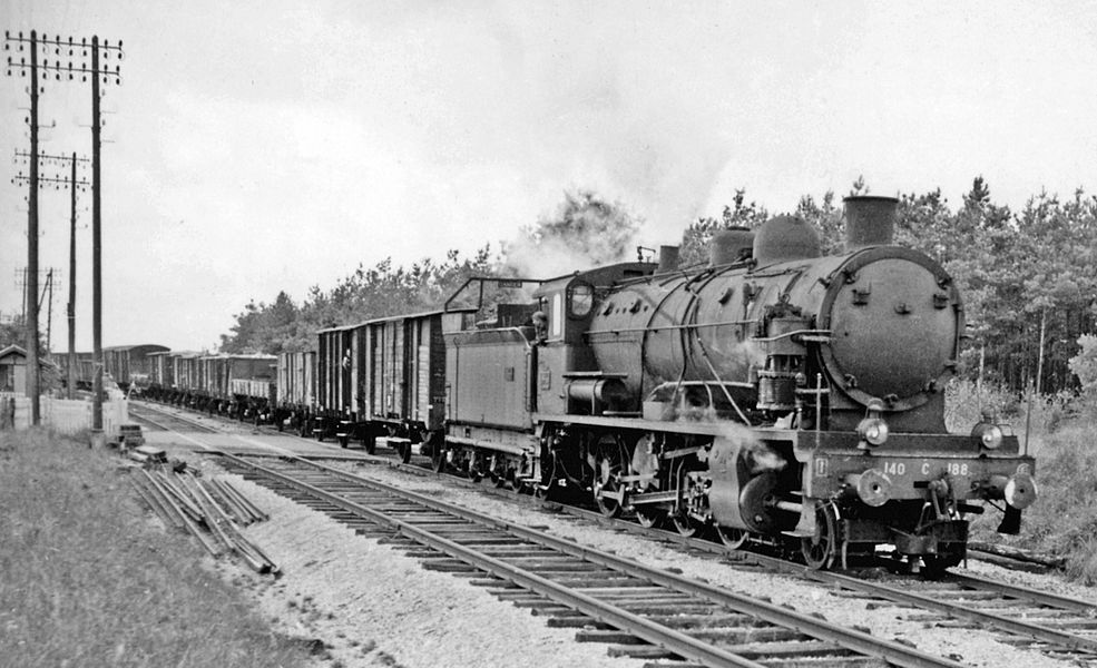 Near Sommesous (Marne)  a SNCF class 140-C 2-8-0 heads a freight on the Troyes - Chalons-sur-Marne line, 1958.