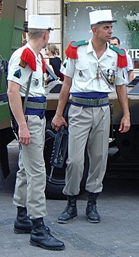 Photograph of two members of the French Foreign Legion dressed in their traditional uniforms.