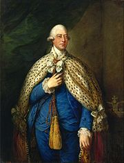 Three-quarter portrait of King George III in his parliamentary robes, a blue suit with a leopard cape.