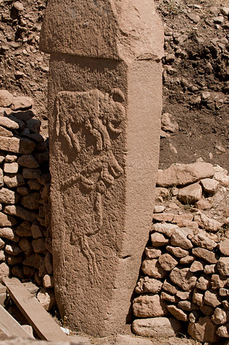 Prehistory of Anatolia - Pillar 2 from Enclosure A (Layer III) with low reliefs of what are believed to be a bull, fox, and crane.