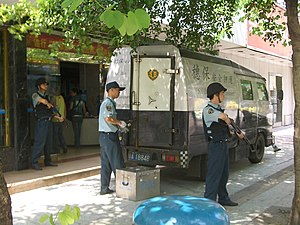 Security guard - Cash in transit van with a crew of security guards in Guangzhou, China