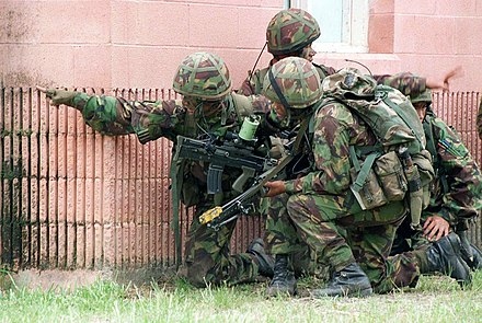 Gurkhas undergoing an urban warfare exercise in the United States. Note the kukri on the webbing of the nearest soldier. Gurkhas exercise DM-SD-98-00170.jpg