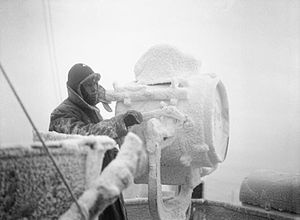 Arctic convoys of World War II - Ice forms on a 20-inch signal projector on the cruiser HMS ''Sheffield'' while she is helping to escort an Arctic convoy to Russia.