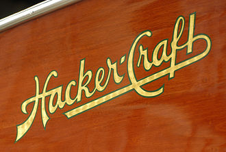 Hacker-Craft - Hacker-Craft's logo, hand-painted in gold leaf on the side of a mahogany runabout