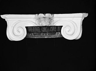 Annulet (architecture) - Unpainted annulet molding between the volutes at the Hammond-Harwood House