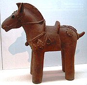 Haniwa horse statuette, complete with saddle and stirrups, 6th century.