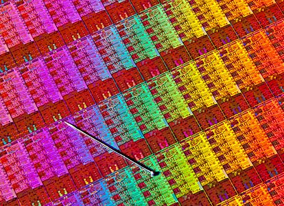 A Haswell wafer, with a pin for scale. See https://en.wikipedia.org/wiki/Haswell_(microarchitecture)