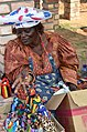 Herero woman selling handcraft (Namibia).jpg