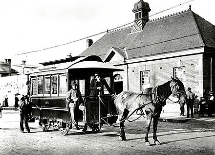 A horse-drawn tram in Sydney, 1894. The city saw Australia's first tram service open in 1860. Horsedrawn tram which ran between Newtown Station and St Peters.jpg