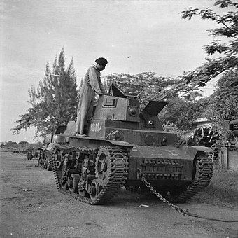 A soldier of an Indian armoured regiment examines a Marmon-Herrington CTLS light tank used by Indonesian nationalists and captured by British forces during the fighting in Surabaya. IWM-SE-5742-tank-Surabaya-194511.jpg
