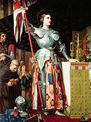 Painting of Joan of Arc in armor holding a flag.