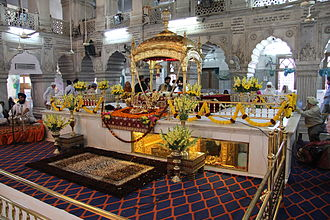 Guru Tegh Bahadur - Gurudwara Sisganj Sahib in Delhi. The long window under the marble platform is the location where Guru Tegh Bahadur was executed.