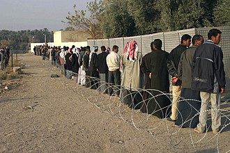 Iraqi parliamentary election, December 2005 - Iraqis wait in line to vote