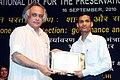 Jairam Ramesh presenting the Medini award to Shri Naveen Kumar Gupta, at the 'International Ozone Day' celebrations, in New Delhi on September 16, 2010.jpg